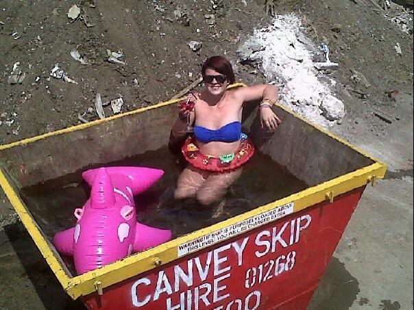 Findaskip girl swimming in a skip