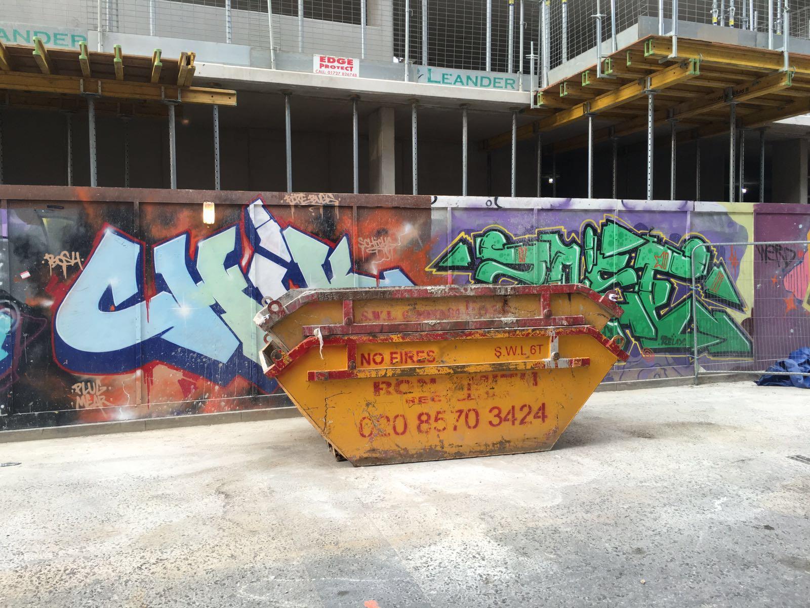 Findaskip Skips in front of graffiti