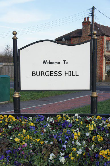 findaskip welcome town sign of burgess hill